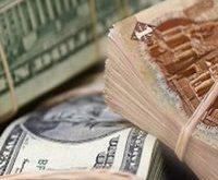 الدولار بـ التجاري الدولي ويسجل 14.95 جنيها